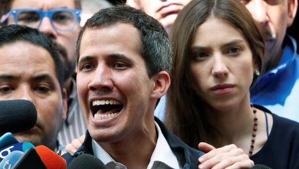 Venezuelan opposition leader and self-proclaimed interim president Juan Guaido accompanied by his wife Fabiana Rosales, speaks to the media after a holy mass in Caracas, Venezuela, January 27, 2019 - Sputnik Italia