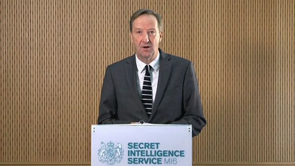 MI6 chief Alex Younger speaks at MI6's Vauxhall Cross headquarters in central London, in this still image from video, Britain December 8, 2016. - Sputnik Italia