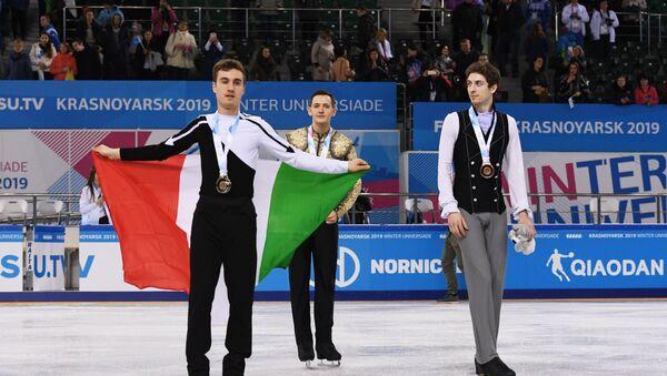 Il podio del concorso individuale di pattinaggio di figura alle Universiadi di Krasnoyarsk 2019: Matteo Rizzo, Italia - Maxim Kovtun, Russia - Moris Kvitelashvili, Georgia - Sputnik Italia