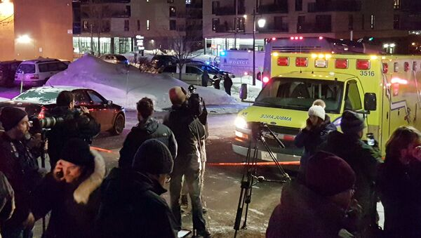 An ambulance is parked at the scene of a fatal shooting at the Quebec Islamic Cultural Centre in Quebec City, Canada - Sputnik Italia