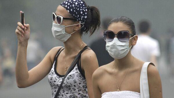 Ragazze con le maschere - Sputnik Italia