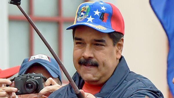 Президент Венесуэлы Николас Мадуро во время марша в Международный День труда (1 мая 2016). Каракас - Sputnik Italia