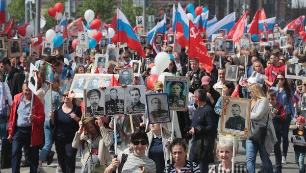 Partecipanti alla marcia del Reggimento Immortale a Mosca - Sputnik Italia