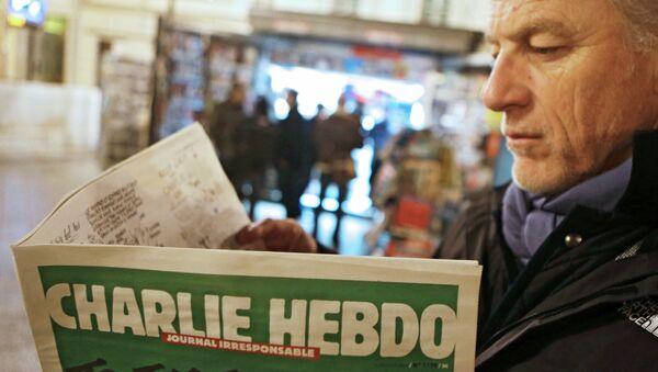 Le premier (après l'attentat ) numéro de l'hebdomadaire français satirique Charlie Hebdo - Sputnik Italia