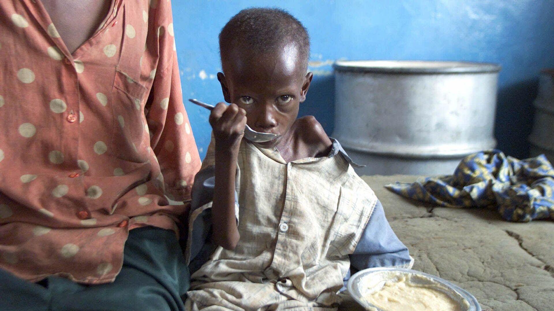 Bambino consumato dalla fame in Congo - Sputnik Italia, 1920, 18.08.2021