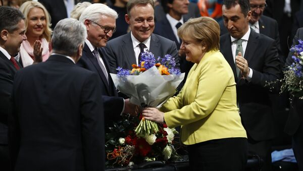 Il presidente tedesco Frank-Walter Steinmeier e il cancelliere Angela Merkel - Sputnik Italia