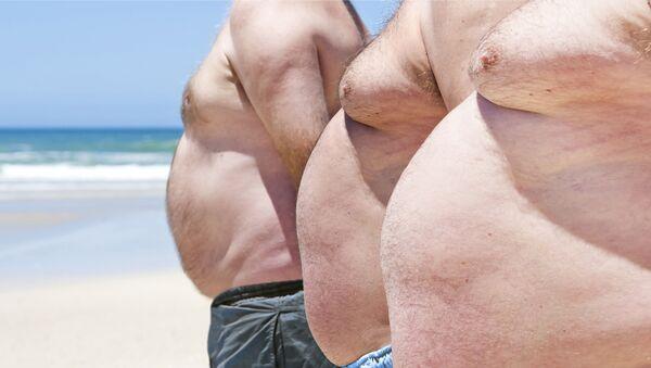 Uomini affetti da obesità - Sputnik Italia