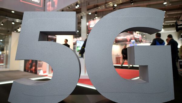 A logo of the upcoming mobile standard 5G is pictured at the Hanover trade fair, in Hanover, Germany March 31, 2019 - Sputnik Italia
