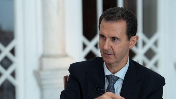 Assad durante un'intervista - Sputnik Italia