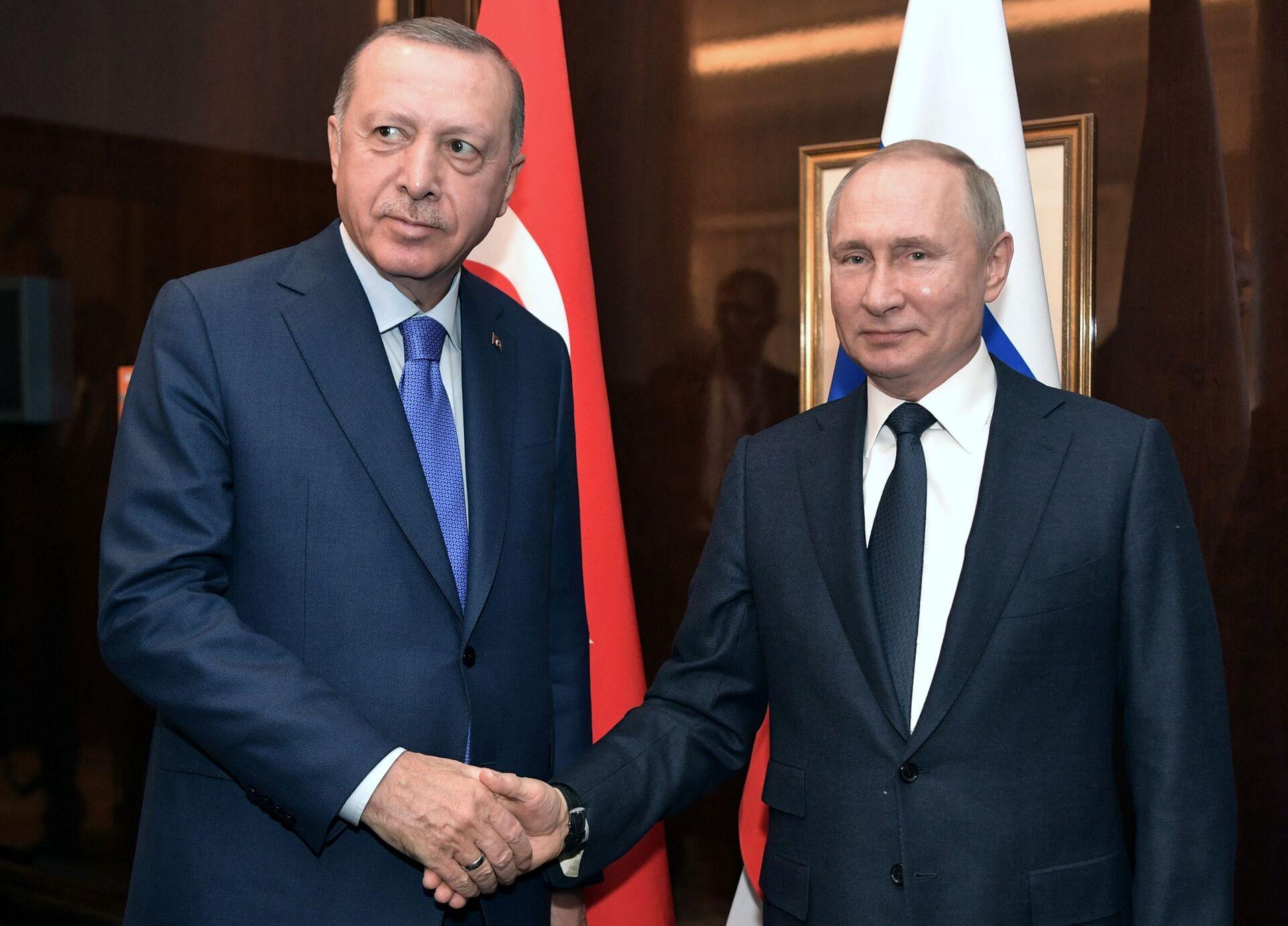 Il presidente russo Vladimir Putin durante un incontro con il presidente turco Recep Tayyip Erdogan alla Conferenza internazionale sulla Libia a Berlino - Sputnik Italia, 1920, 28.09.2021