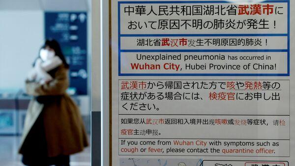 Уведомление о вспышке коронавируса в китайском Ухане в международном аэропорту Токио - Sputnik Italia