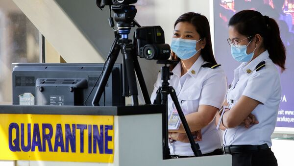 Personale aeroportuale filippine - Sputnik Italia