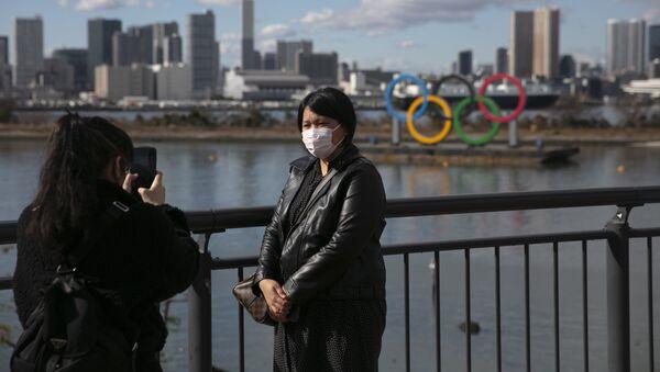 Turisti con le mascherine a Tokyo, Giappone - Sputnik Italia
