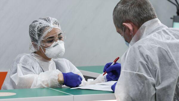 Il test su coronavirus condotto a Sinferopoli - Sputnik Italia