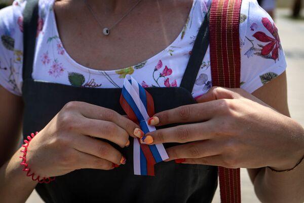 Una partecipante alle celebrazioni del Giorno della Russia nel Parco dell'amicizia della città di Georgievsk, territorio di Stavropol, Russia - Sputnik Italia