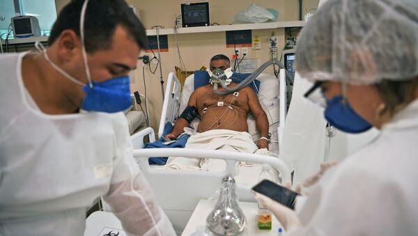 Un paziente COVID-19 in Brasile - Sputnik Italia